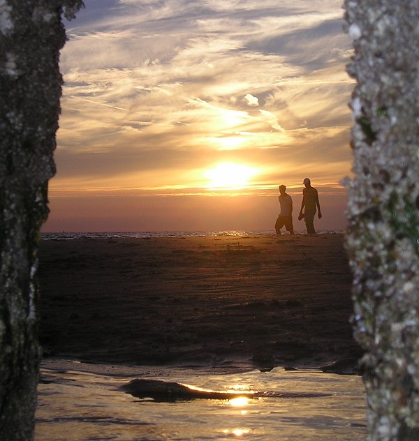 ondergaande zon strand